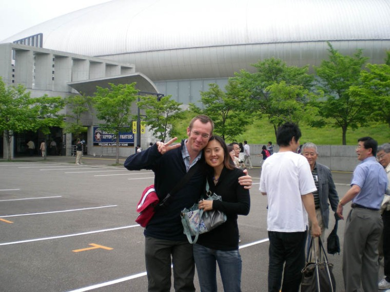 In front of the excellent Sapporo Dome. Note the mini fake messenger bag.