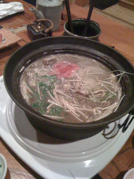 Here's a pot of boiling water with the remnants of some vegetables in it.